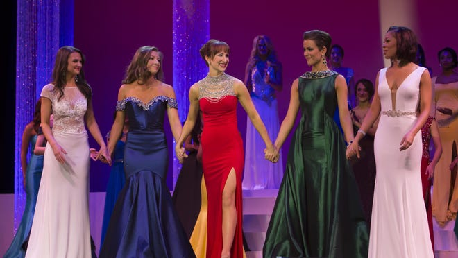 Miss River City Christa Brehm, center, a 2011 graduate of Lincoln High School, holds hands with other contestants in the Top 5 during the Miss Wisconsin Scholarship Pageant Saturday at the Alberta Kimball Auditorium in Oshkosh. Brehm was named fourth runner-up.
