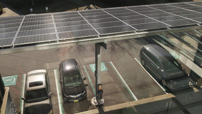 The newly installed solar-powered car charging station at the Public Utilities Commission in Warwick in February.