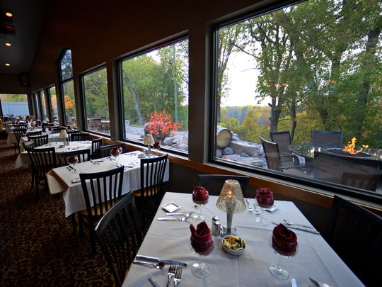 A bank of windows running the length of a wall give every guest a panoramic view of the trees and bay of Green Bay at The English Inn in the town of Scott.