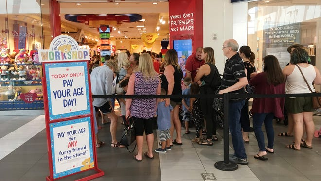 """Fans wait in line for Build-a-Bear's """"Pay Your Age"""" sale Thursday, July 12, 2018, at CoolSprings Galleria in Franklin, Tenn."""