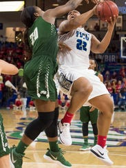 China Dow of FGCU is fouled by Shalonda Neely of Jacksonville
