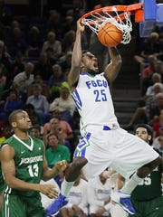 FGCU's Marc-Eddy Norelia scores against Jacksonville in January at Alico Arena in Fort Myers.