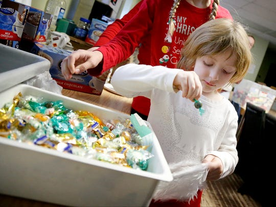Six-year-old Meghan Cleary, of Big Flats, drops a candy