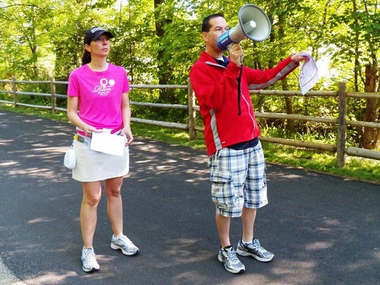 Keith Axelrod, right, calls out instructions to runners at a past Dutchess County Classic.