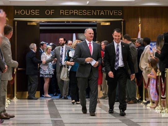 Florida House Speaker Richard Corcoran, center left,