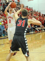 Tyler Taylor shoots the ball for Plymouth during their