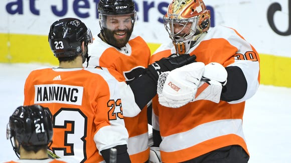 Goalie Michal Neuvirth made 30 saves in his first win
