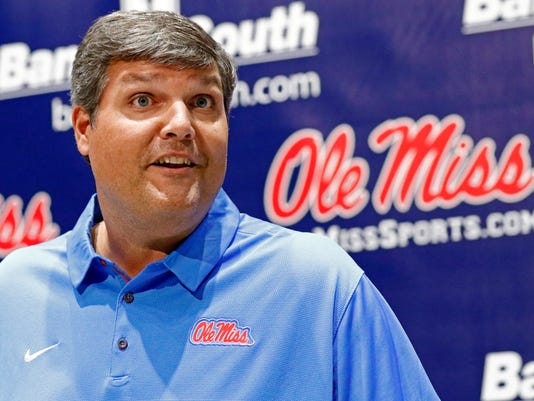 FILE - In this Aug. 2, 2017, file photo, Mississippi interim football coach Matt Luke discusses his expectations for the NCAA college football team's season, in Oxford, Miss. Ex-Ole Miss coach Ed Orgeron is back in the SEC West at LSU. His former program is trying to regroup from the July 20 resignation of Hugh Freeze while in the final stretch of an NCAA investigation. (AP Photo/Rogelio V. Solis, File)