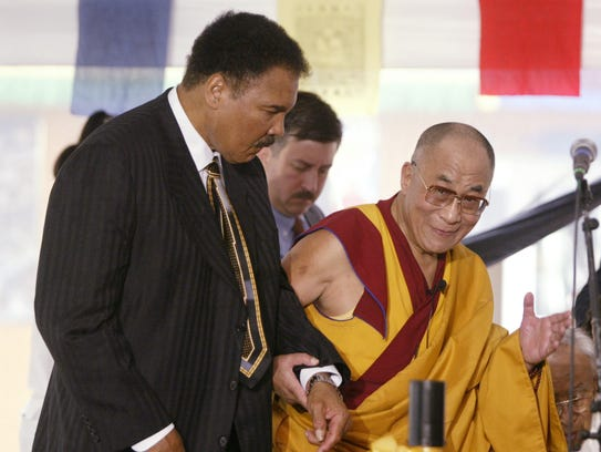 9/7/03.  Mohammed Ali left is escorted by His Holiness