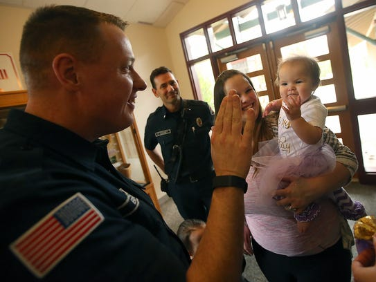 Eleanor Rogers was born on Feb. 6, 2017, in the back of a North Kitsap Fire and Rescue ambulance near the intersection of Highways 307 and 305. NKFR's Craig Barnard, left, delivered her.
