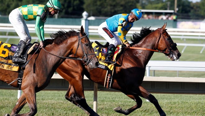 In this Sunday, Aug. 2, 2015 file photograph, jockey Victor Espinoza, right, on Triple Crown winner American Pharoah(4), looks back at jockey Kent Desormeaux on Keen Ice (6) after American Pharoah won the Haskell Invitational horse race at Monmouth Park in Oceanport, N.J. Keen Ice was second. Monmouth Park is preparing to open its gates May 2016, for a new season as New Jersey's horse racing industry deals with sagging track attendance and betting numbers. Races can still draw large crowds, but usually only when they are considered a marquee event. Monmouth Park drew a record crowd when American Pharoah won the Haskell Invitational.