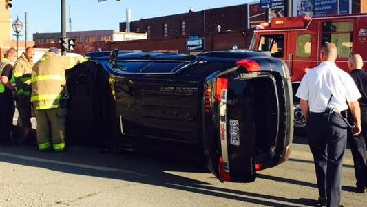 Crews respond to a crash at North Diamond and East Third streets Wednesday in downtown Mansfield.
