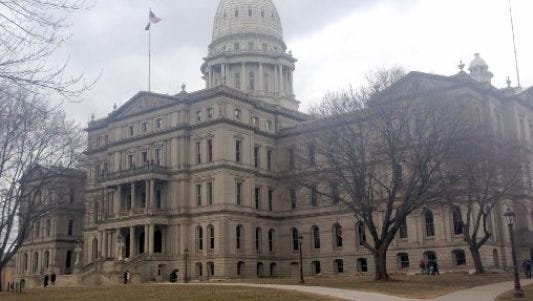 State officials met at the Capitol Thursday to estimate state revenues for the next few years.