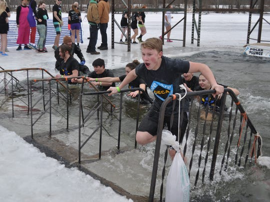 Wausau West DECA members make a quick exit from the icy water.