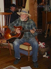 Bob Gore plays the guitar during one of the Forest