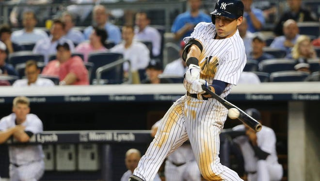 Yankees center fielder Jacoby Ellsbury doubles to left, scoring shortstop Brendan Ryan in the third inning Tuesday against the Detroit Tigers.