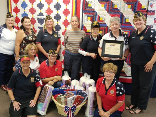 636118622031261625-Quilts-of-Valor-donation.jpg