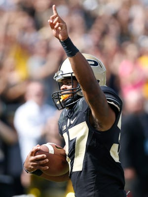Brian Lankford-Johnson points a finger skyward as he sprints into the end zone for a touchdown against Eastern Kentucky with 4:23 remaining Saturday, September 3, 2016, at Ross-Ade Stadium. Purdue defeated Eastern Kentucky 45-2