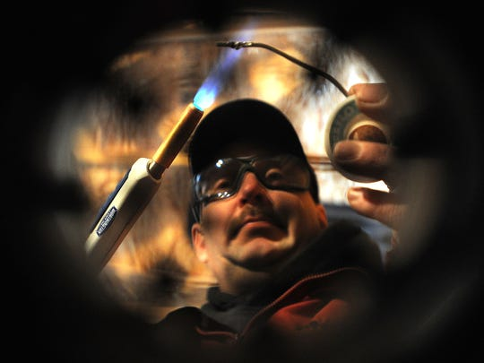 Tom Matuszeski of Ahern-Gross Plumbing uses a torch