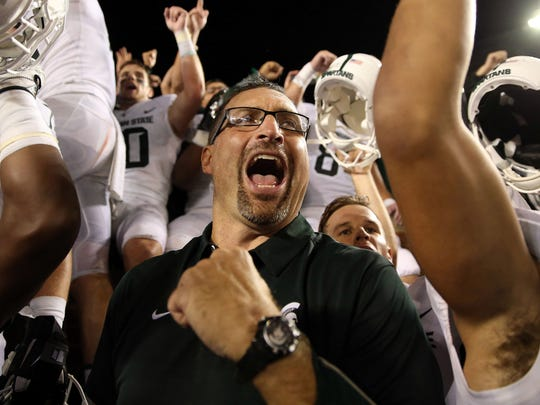 Michigan State offensive line coach Mark Staten celebrates the 14-10 win over Michigan on Oct. 7, 2017.