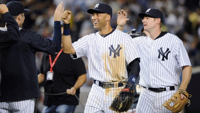 The Yankees' Derek Jeter and Chase Headley celebrate after the Yankees defeated the Toronto Blue Jays 6-4  Friday night at Yankee Stadium.