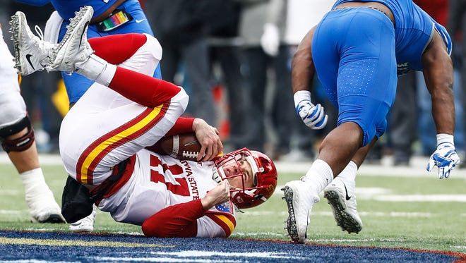 Memphis defender Genard Avery (right) sacks Iowa State quarterback Kyle Kempt (left) during fourth quarter action of the AutoZone Liberty Bowl in Memphis, Tenn., Saturday, December 30, 2017.