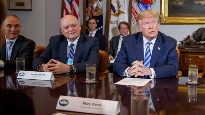 President Donald Trump speaks during a meeting with automotive executives in the White House, Friday, May 11, 2018, in Washington. From left, Environmental Protection Agency administrator Scott Pruitt, Ford CEO James Hackett and Trump.