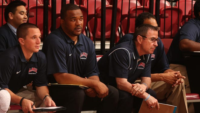 Senque Carey, second from right, and Tom Abatemarco, third from right, coached together at Loyola Marymount.