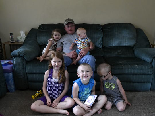 John Lake Jr. and his five grandkids pose for a photo,