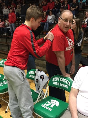 Blackford freshman Luke Brown signs an autograph before the Bruins' game against Yorktown in the opening round of sectional.