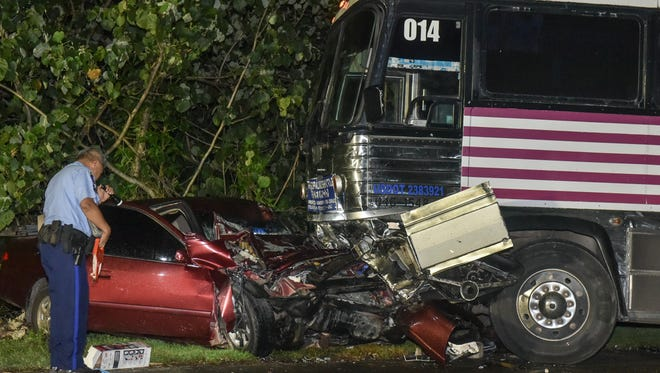 The wreckage of a Toyota Camry rests along LeoPalace road on Sept. 26, after colliding head-on with a tour bus. The driver of the Camry was pronounced dead at Naval Hospital Guam at 6:34 P.M., according to the Guam Police Department.