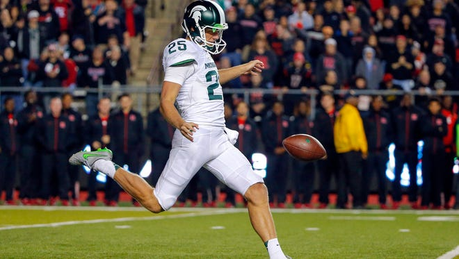 Michigan State redshirt freshman Jake Hartbarger punts the ball against Rutgers on Oct. 10. Hartbarger's issues handling snaps caused the coaches to use backup Tyler O'Connor as the Spartans' punter at Michigan.