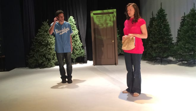 """James Malouf as """"East,"""" and Mozelle Stoiber as """"Glory,"""" rehearse their scene, """"Her Heart,"""" one of the nine stories told in """"Almost, Maine."""" The Wisconsin Rapids Community Theatre production opens May 15."""