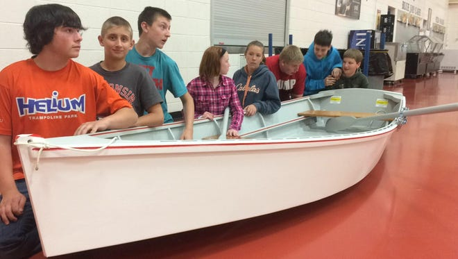 The eight Prairie River Middle School students who did the most work in building the 12-foot skiff are: (left to right) Nick Oslage, Dawson Heckendorf, Caleb Timm, Trinity Kanitz, Alli Blaubach, Nick Nowak, Zander Jaeger, and Alex Longren.