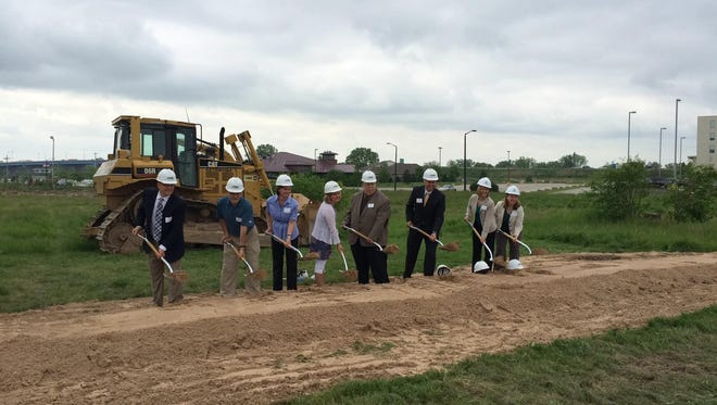 A ceremonial groundbreaking was held Thursday at the site of a 103-unit Residence Inn by Marriott on Marina Lane in Ashwaubenon.