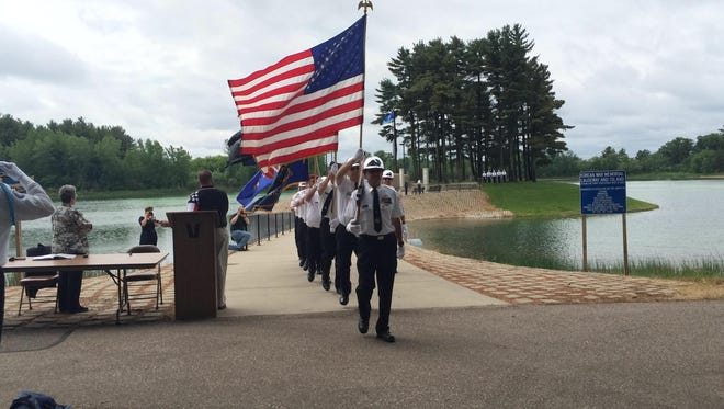 Members of the Veterans of Foreign Wars Post 10262 march during a program and ceremony held Sunday at the Wisconsin Korean War Veterans Memorial in the village of Plover.