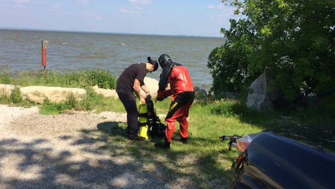 The Green Bay Police Department Dive Team is searching the water of Green Bay in connection to the shooting death of Krustal R. Torres-Smith.