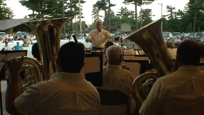 Bob Kaiser directs the city band at Robinson Park in Wisconsin Rapids during a 2014 concert.