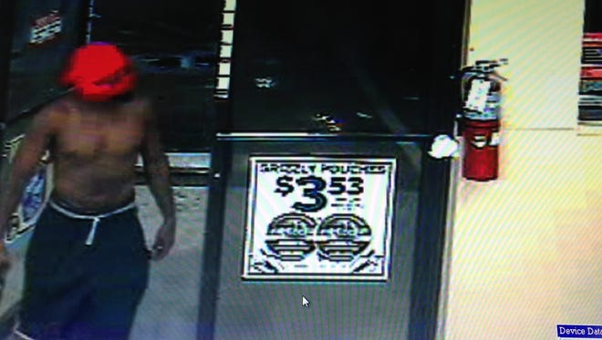 A surveillance video still shows the suspect wanted for the armed robbery of a Circle K store in Palm Bay.
