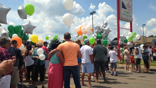 Family and friends of Jay and Julie Hogan released balloons on Sunday in a memorial to the couple killed in a car crash on Thursday night.