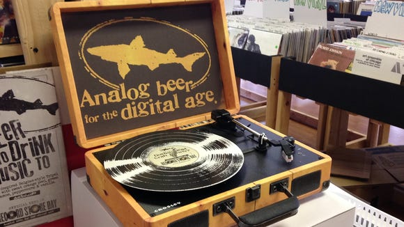 Jupiter Records in Woodbury Heights, with Telford Inn, Joe Canals and Dogfish Head Brewery are giving away a limited edition turntable Saturday for National Record Store Day.