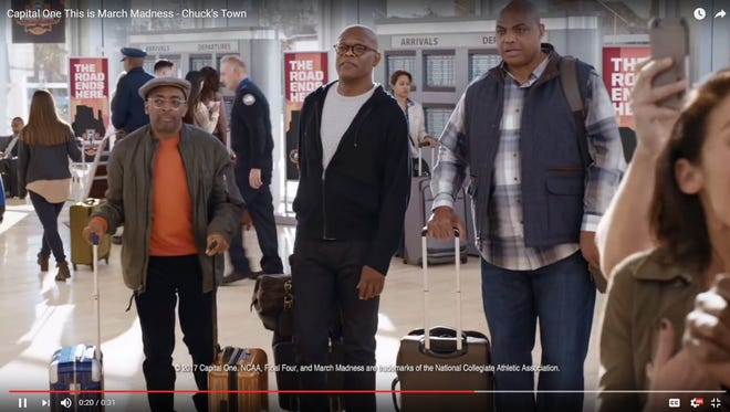 A screenshot of a Capital One commercial in which Charles Barkley (right) tells Spike Lee (left) and Samuel L. Jackson they are in Phoenix.