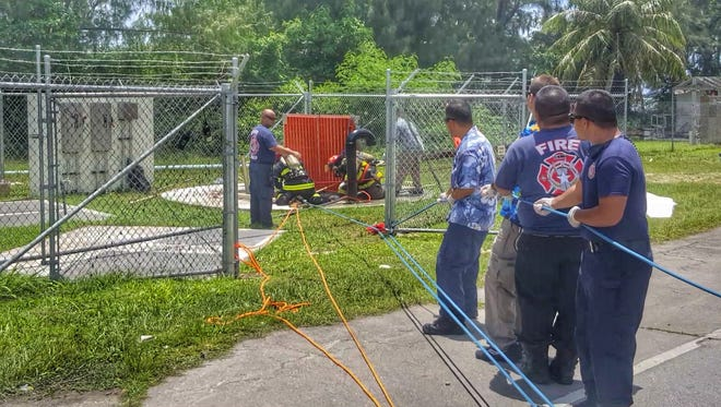 CNMI Department of Fire and Emergency Medical Services pull the bodies of three workers from a main sewer well on Saipan Friday. The three were pronounced dead at 1:32 p.m. Friday July 7, 2017.