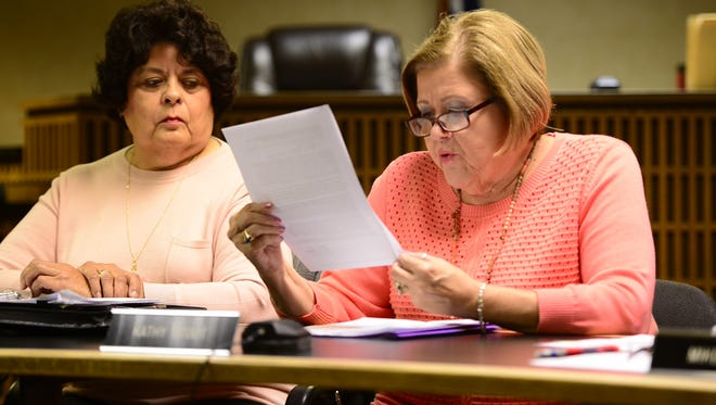 Fremont City Councilwoman Kathy Stout reads a letter citing the benefits of medical marijuana from Steve Fought, the mayor of Gibsonburg, where a medical marijuana production facility has been proposed.