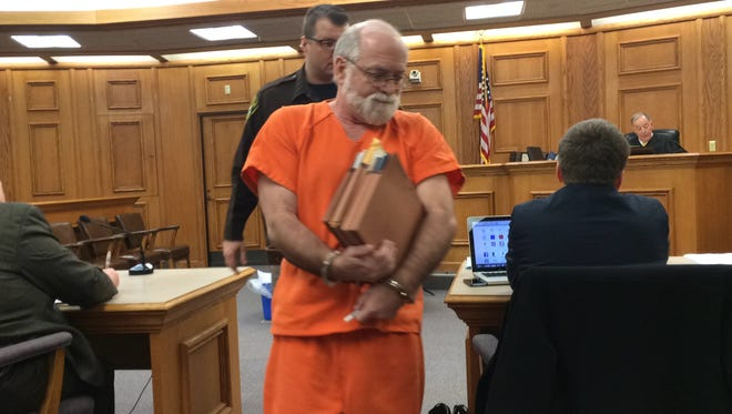 Murry Locke, 62, prepares to join his lawyer at Wednesday's sentencing in Oconto County Circuit Court in Oconto.