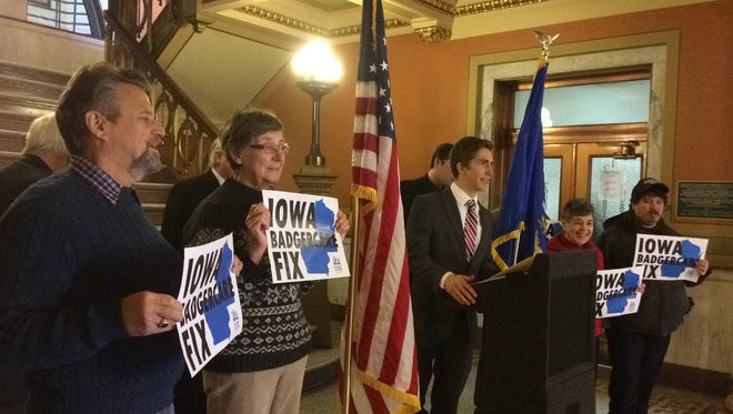 People calling on Wisconsin to accept federal Medicaid expansion dollars stand next to Rep. Dan Riemer, D-Milwaukee, as he announces compromise legislation to obtain the federal funds while in Green Bay on Thursday.