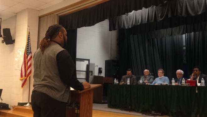 T.J. Smith, a substitute teacher at Arcadia High School, speaks at a public hearing about Accomack County Public Schools' early retirement plan on March 23.