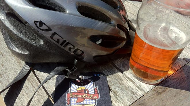 A bike helmet and pint of beer from Indiana on Tap's inaugural Tour de Biere event in Bloomington.