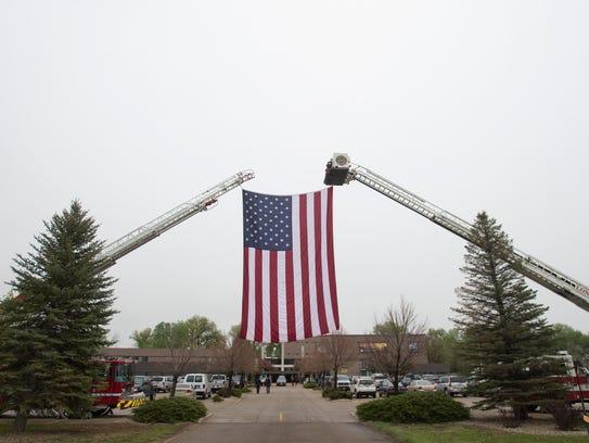 A large United States flag hangs above LifeBridge Christian