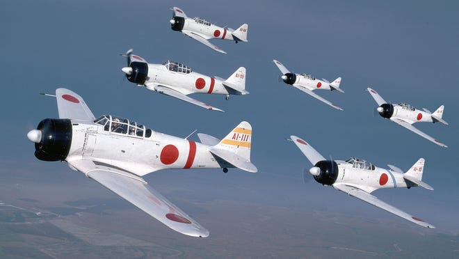 """Japanese Zeroes, part of the Commemorative Air Force's specialty act """"Tora, Tora, Tora,"""" reenact the bombing of Pearl Harbor. The act will be part of the 2015 Reno National Championship Air Races."""